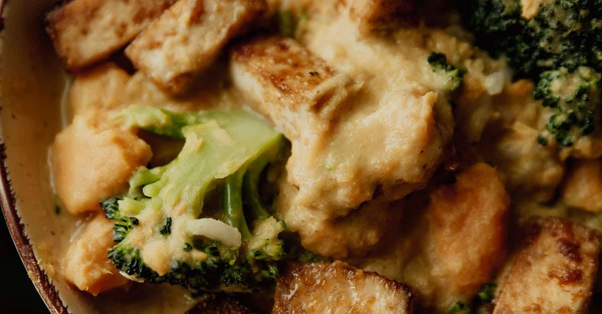 A close up of a plate of food with broccoli