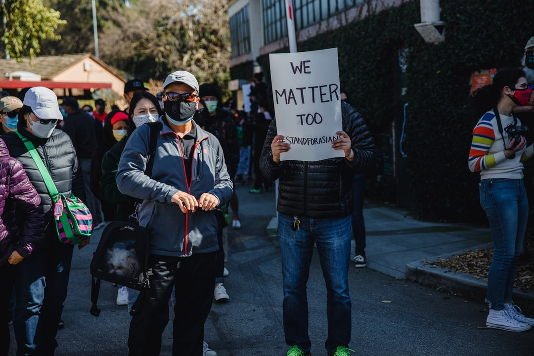 A group of people holding signs