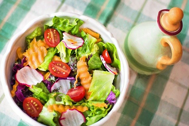 A bowl of fruit and vegetable salad on a plate
