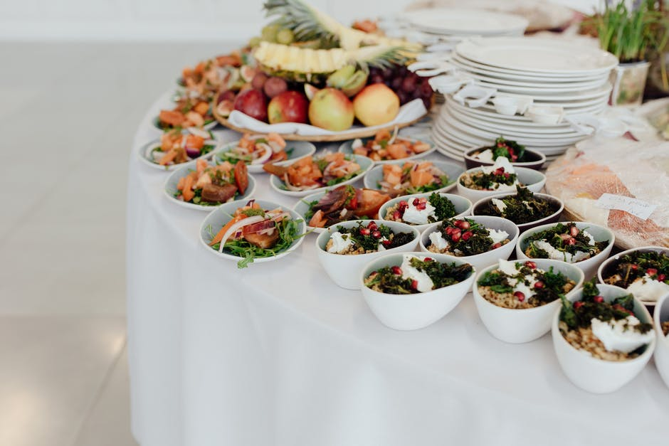 A table topped with plates of food on a plate